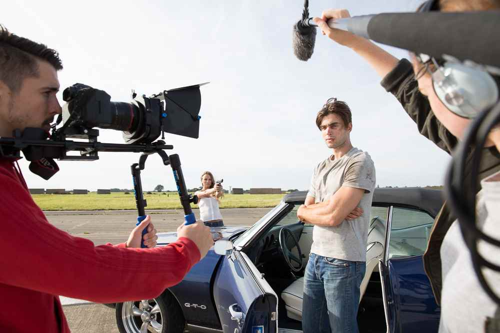 Film crew and actors on set shooting a film