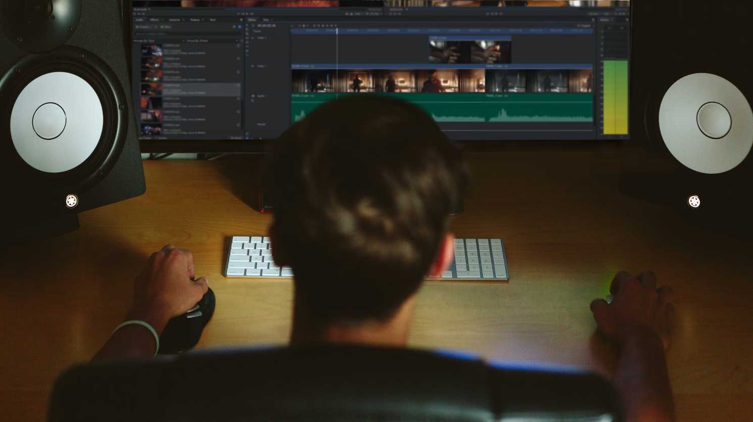 VFX artist working at a desk on HitFilm Pro VFX software - what does a VFX artist do?