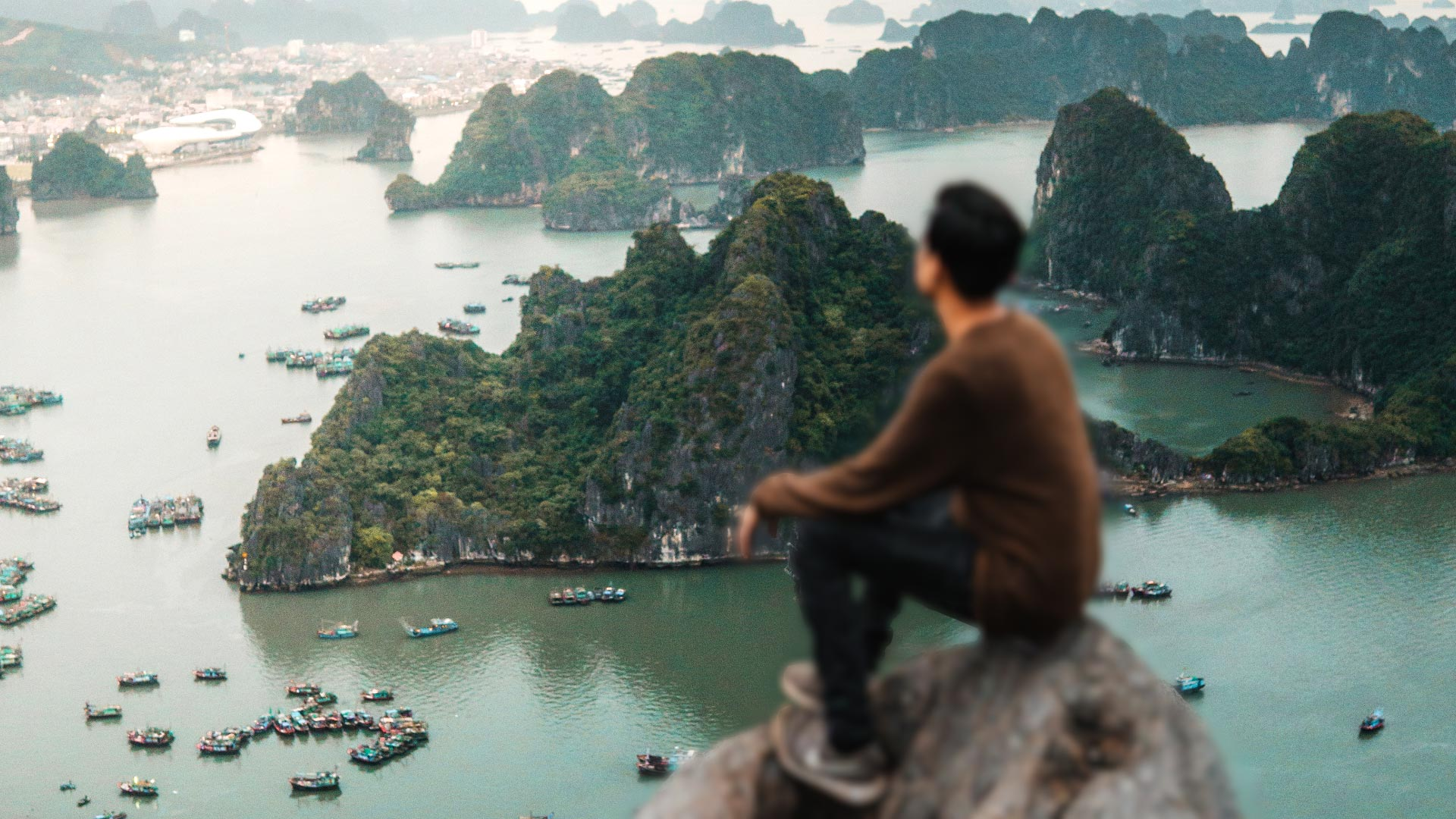 Background focus man sat on rock overlooking bay in south east asia focus stacking in Imerge Pro