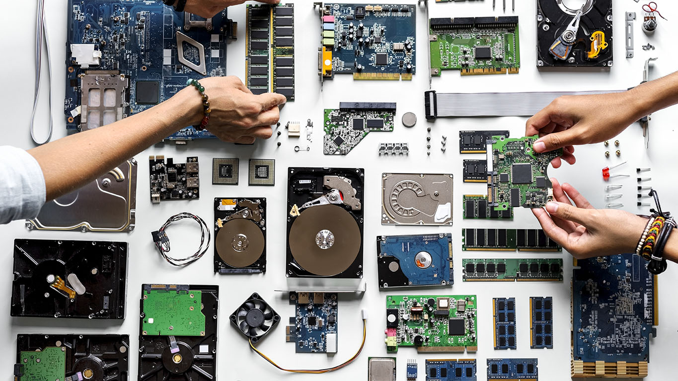 PC components on a table with hands