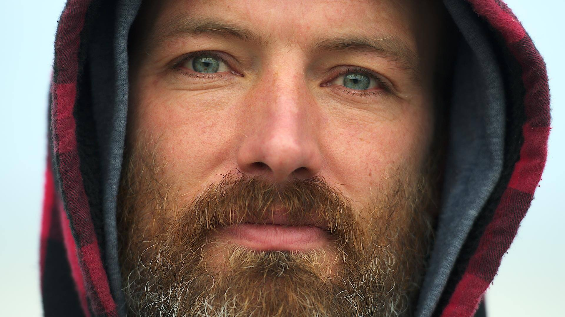 Close up portrait of man with beard and red checker hood - structure effect before