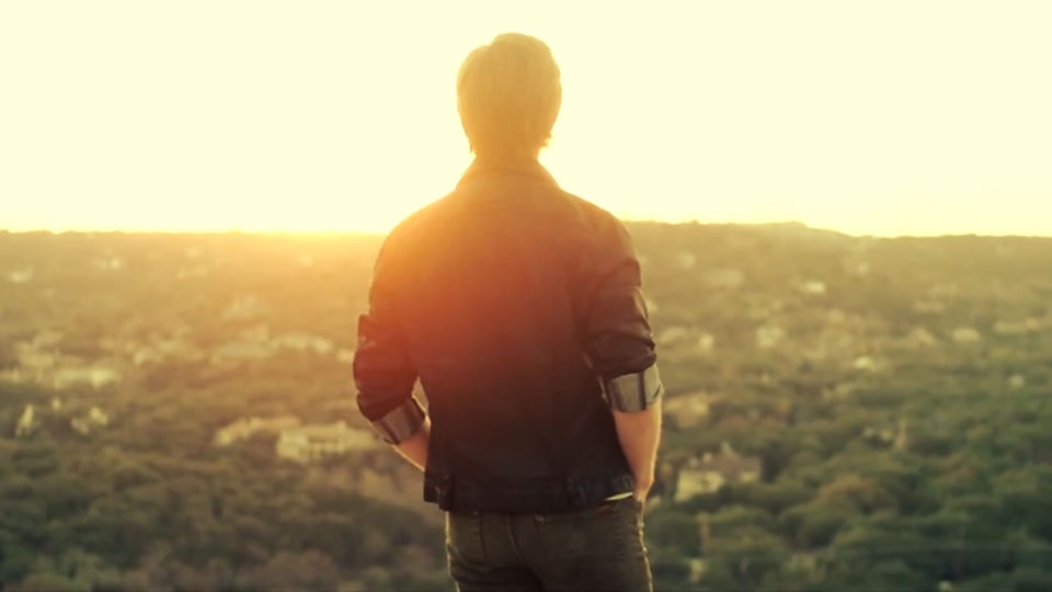 How to win 48-hour film contests - man watching sunset overlooking the city