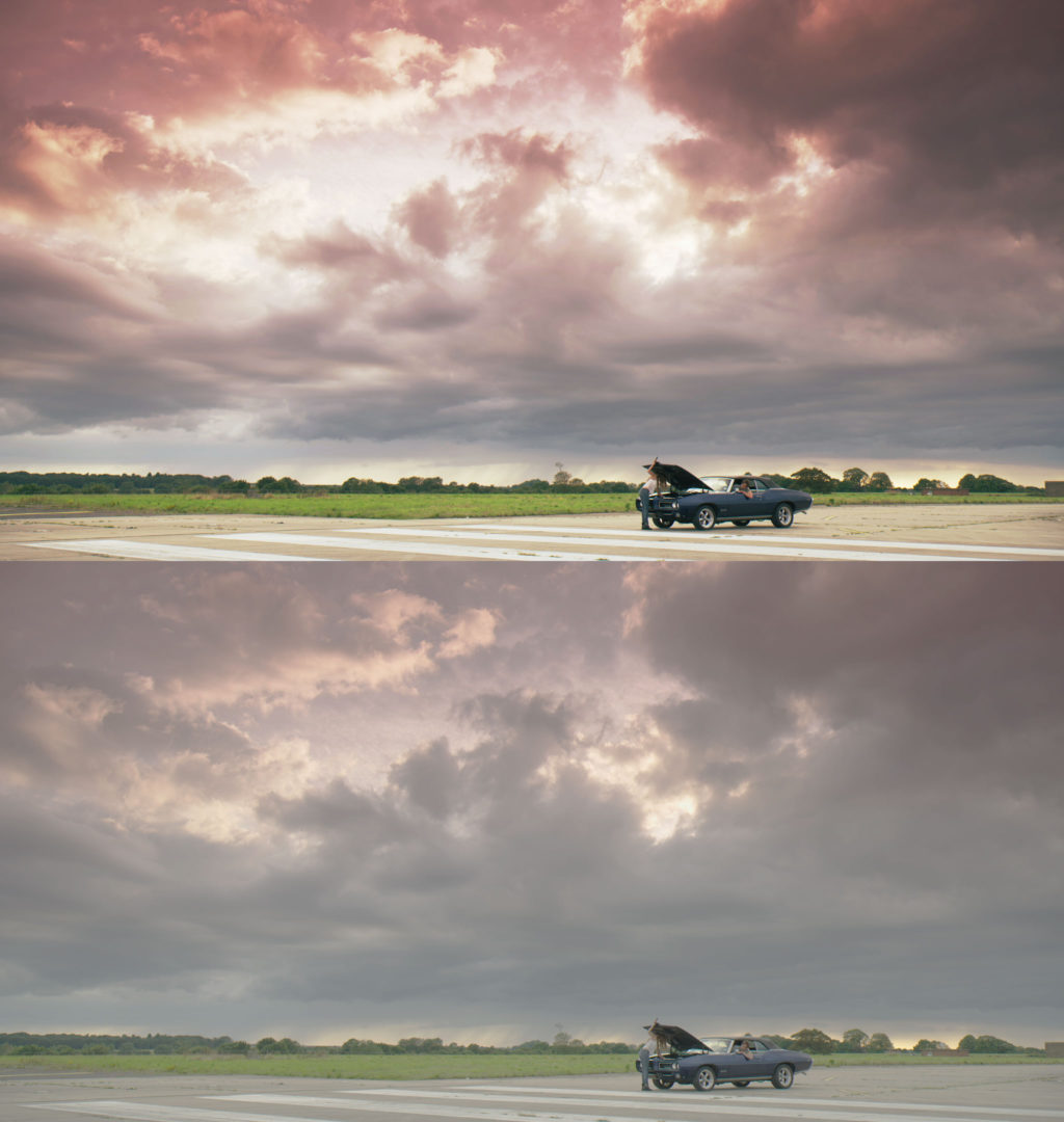 Graded vs Ungraded -  Wide shot of girl looking under car bonnet on airfield while man leans out of window