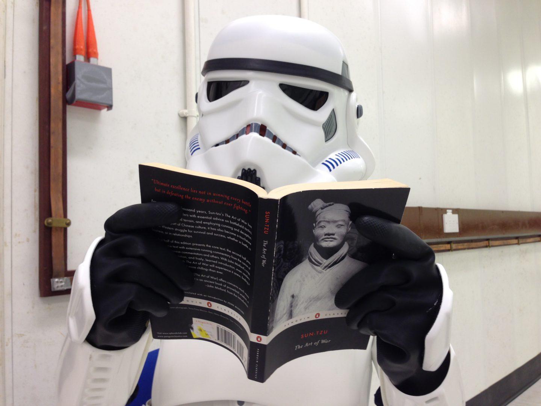 Stormtrooper reading 'The Art of War' by Sun Tzu