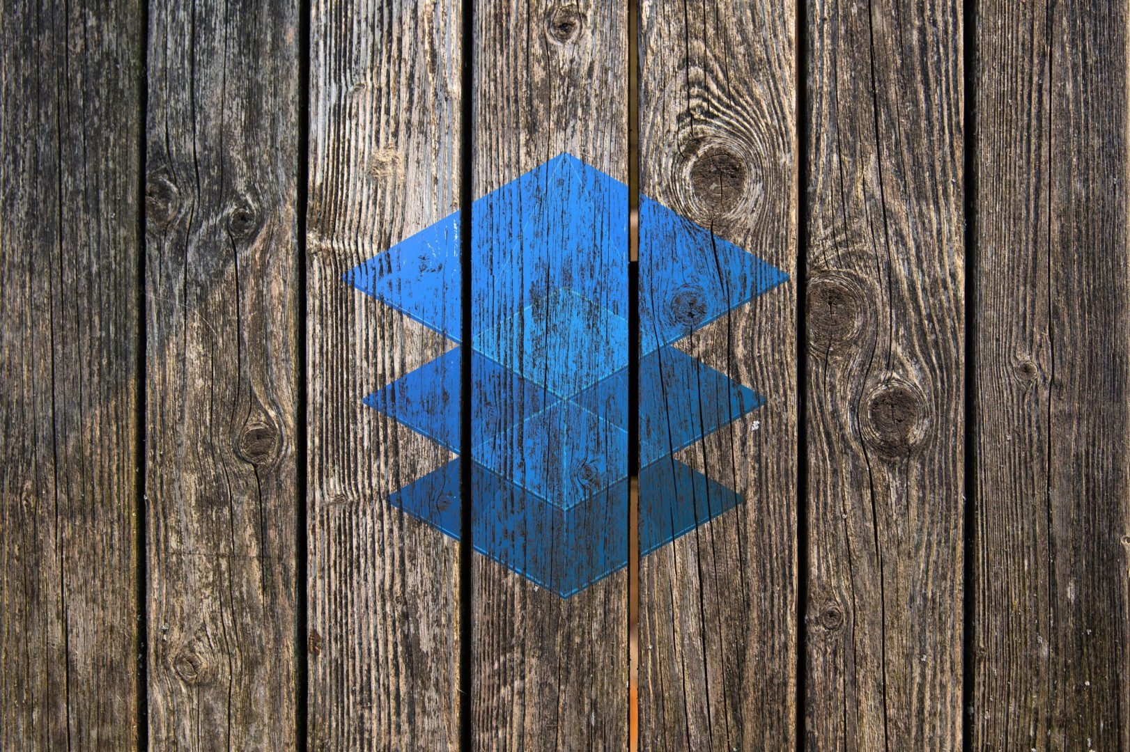 Imerge Pro logo blended on wooden plank background (Blend-If blending mode)