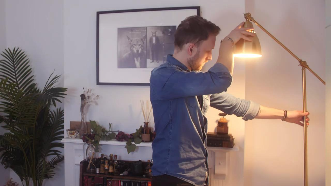 Tom adjusting household lighting, - How to improve your webcam quality