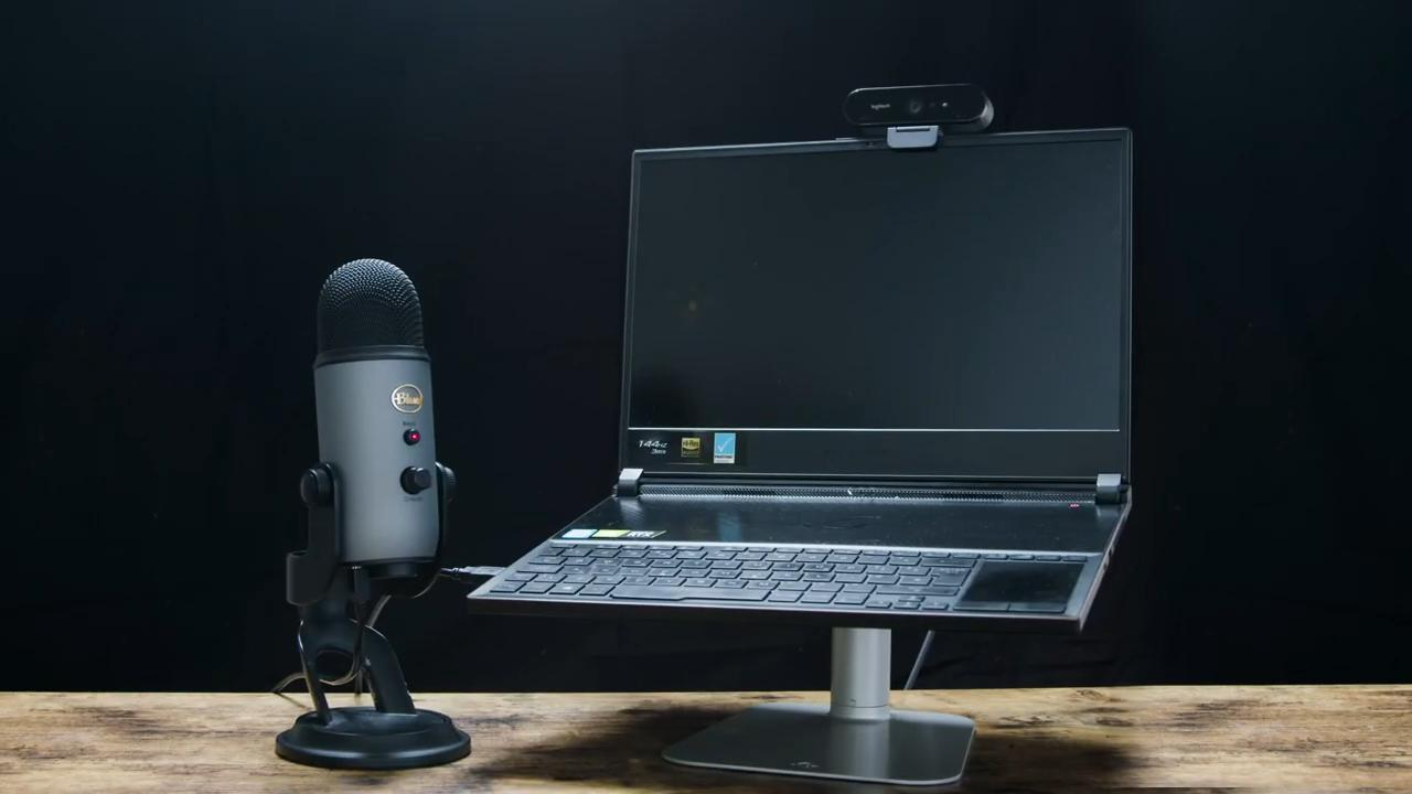 Streaming setup with laptop, webcam, and Yeti mic