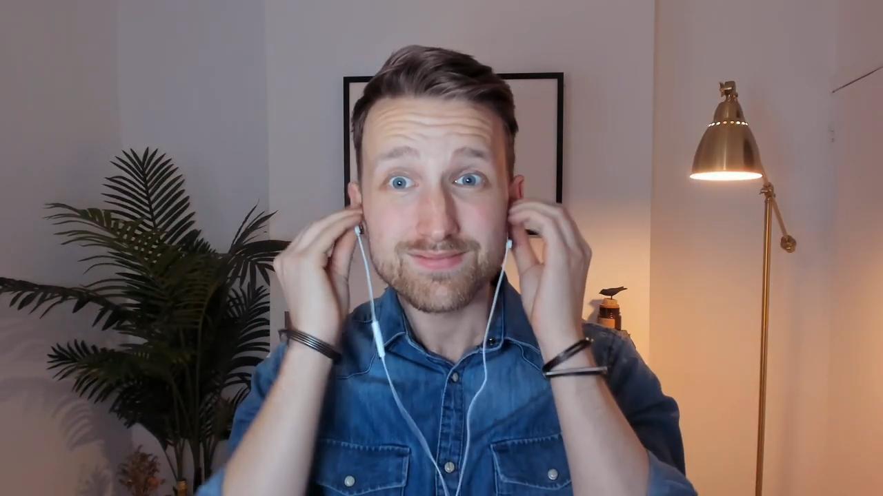 Tom putting headphones in