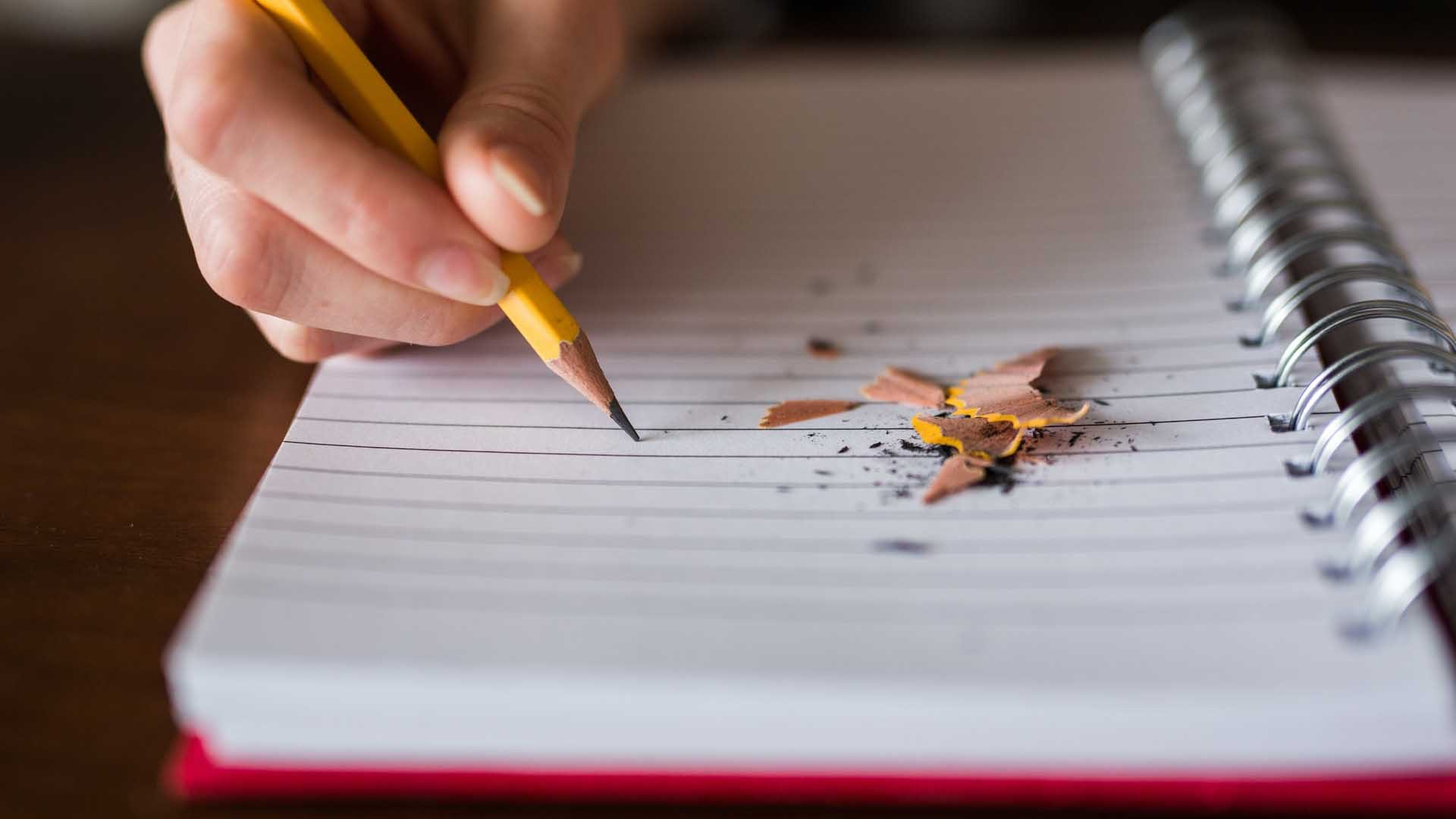 Scriptwriting/screenwriting - notebook with pencil and pencil shavings