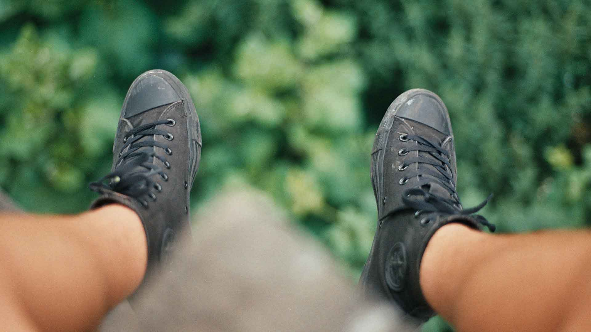 What is depth of field - POV of converse trainers hanging from ledge